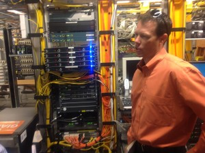 The Giants' Bill Schlough in front of some hard-working wireless network hardware. Credit: John Britton, AT&T.