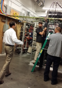 Giants CIO Bill Schlough (left) talks with workers in the park's main DAS head end facility.