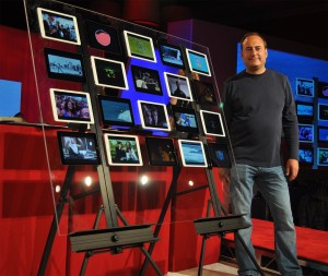 "Artemis Networks CEO Steve Perlman shows off a ""wall"" of iPads, all simultaneously running video off one 5 MHz LTE channel via an Artemis pCell network. Credit: Artemis Networks."