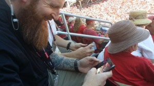 Niners VP of technology Dan Williams attempts to fix my Droid 4 Wi-Fi issues (while trying not to laugh at the fact that I actually have and use a Droid 4) during the first preseason game at Levi's Stadium, July 2014
