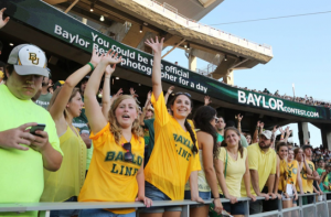 Baylor students standing at football game. Photo credit: Rod Aydelotte, WacoTrib.com