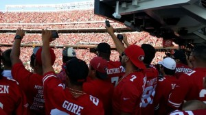 Fans take pictures of opening kickoff from southwest concourse. Credit, all photos: Paul Kapustka, MSR