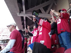 Niners fans get their phone cameras busy for kickoff ceremonies.