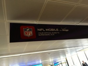 Verizon's NFL Mobile ads were in airport walkways well before the Big Game