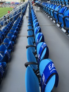 Seats with promo scarves. The team asked fans to donate if they wanted to keep the scarves.