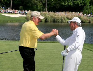 Gary Player (R) congratulates Jack Nicklaus after Nicklaus' hole in one (Sam Greenwood/Augusta National)