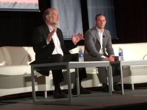 VenueNext CEO John Paul, left, and Niners COO Al Guido discuss Levi's Stadium at a ticketing conference this past spring.