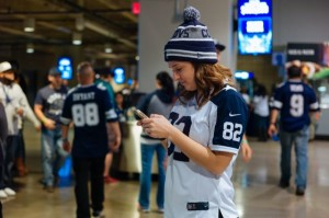 Dallas fan in mobile action at AT&T Stadium. Photo: Phil Harvey, MSR