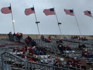 Antennas on flag poles atop seating