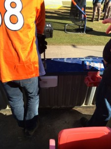 Field-level Wi-Fi AP (small white box next to right leg of Peyton Manning fan)