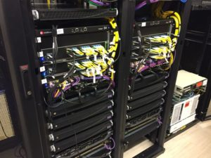 The Wi-Fi backend consists of two ExtremeSwitching bonded S4 Chassis; yellow wires are single-mode fiber optic patch cables and the purple cables are for Wi-Fi infrastructure. Credit: Buffalo Bills / Extreme