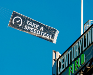 Ookla ad banner being flown over CenturyLink Field in Seattle. Credit: Ookla