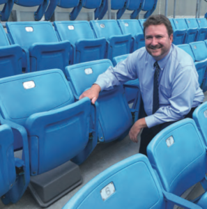 Carolina Panthers director of IT James Hammond shows off a new under-seat Wi-Fi AP at Bank of America Stadium. Credit: Carolina Panthers