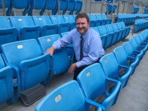 James Hammond, director  of IT for the Panthers, poses next to an under-seat Wi-Fi AP. Credit all photos: Carolina Panthers