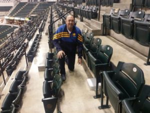 Pacers director of IT Kevin Naylor shows off a new under-seat Wi-Fi AP